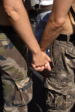 256px-Gay_Couple_from_back_hand_holding_on_CSD_2006_Berlin_-_Make_Love_Not_War